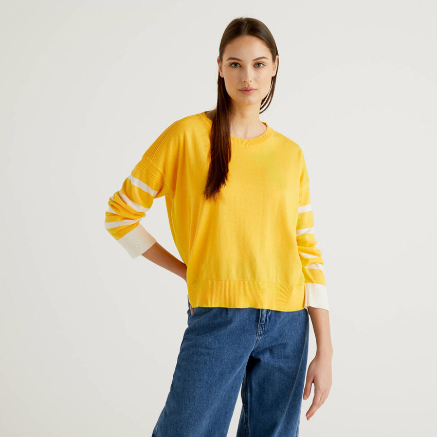 Yellow sweater with slit on the back