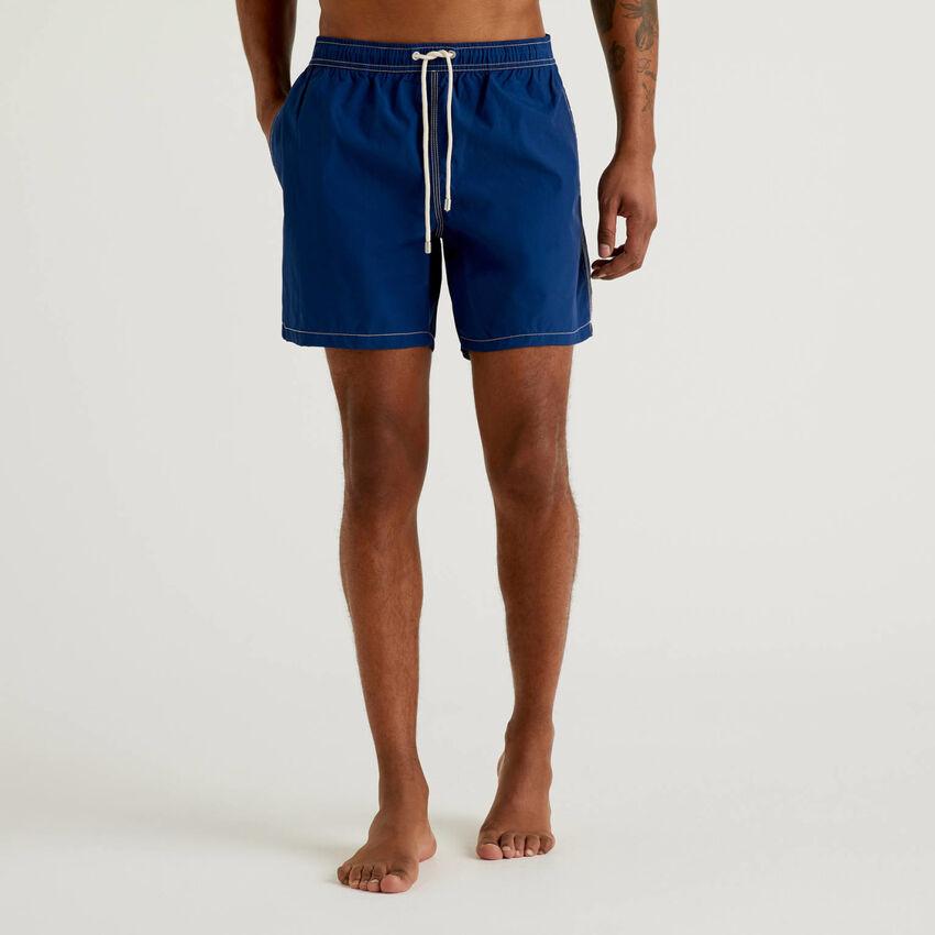 Swim trunks with clashing details